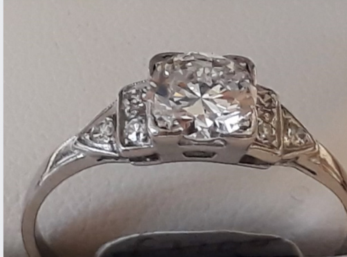 Vintage art deco solitaire. Bright , high clarity round diamond in square setting. Approx 0.70ct Platinum mount with diamond set shoulders Finger size Q Was £2430 now £1822!!